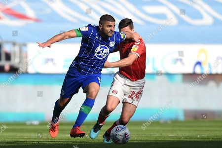 21st September 2019, DW Stadium, Wigan, England; Sky Bet Championship Football, Wigan Athletic vs Charlton Athletic ; Sam Morsy (5) of Wigan Athletic wins the tackle over Josh Cullen (24) of Charlton Athletic 