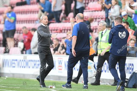 21st September 2019, DW Stadium, Wigan, England; Sky Bet Championship Football, Wigan Athletic vs Charlton Athletic ; Paul Cook manager of Wigan Athletic and Lee Bowyer manager of Charlton Athletic shake hands at the end of the game