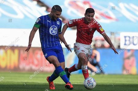 21st September 2019, DW Stadium, Wigan, England; Sky Bet Championship Football, Wigan Athletic vs Charlton Athletic ; Sam Morsy (5) of Wigan Athletic and Josh Cullen (24) of Charlton Athletic contest the ball 