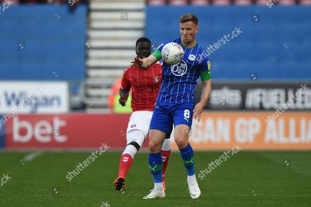 Stock Photo of 21st September 2019, DW Stadium, Wigan, England; Sky Bet Championship Football, Wigan Athletic vs Charlton Athletic ; Lee Evans (8) of Wigan Athletic in action during the game
