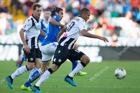 Brescia's Alessandro Matri chases Udinese's Rodrigo Becao.