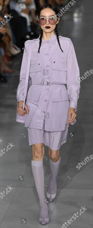 Stock Image of Chinese Fei Fei Sun model presents a creation by Max Mara during the Milan Fashion Week, in Milan, Italy, 19 September 2019. Spring-Summer 2020 women's collections are presented at the Milano Moda Donna from 17 to 23 September.