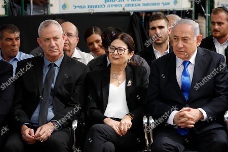 Blue and White party leader Benny Gantz, left, Esther Hayut, the Chief Justice of the Supreme Court of Israel, and Prime Minister Benjamin Netanyahu attend a memorial service for former President Shimon Peres in Jerusalem, . Israelis are contending with the prospect of a third election, two days after an unprecedented repeat election left the country's two main political parties deadlocked, with neither Prime Minister Benjamin Netanyahu nor his rivals holding a clear path to a coalition government