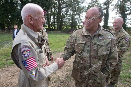 Tom Rice, a 98-year-old American WWII veteran, is greeted by British paratroopers after landing wit a tandem parachute jump near Groesbeek, Netherlands, as part of commemorations marking the 75th anniversary of Operation Market Garden. Rice jumped with the U.S. Army's 101st Airborne Division in Normandy, landing safely despite catching himself on the exit and a bullet striking his parachute