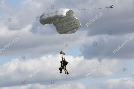 Tom Rice, a 98-year-old American WWII veteran, front left, approaches the landing zone in a tandem parachute jump near Groesbeek, Netherlands, as part of commemorations marking the 75th anniversary of Operation Market Garden. Rice jumped with the U.S. Army's 101st Airborne Division in Normandy, landing safely despite catching himself on the exit and a bullet striking his parachute