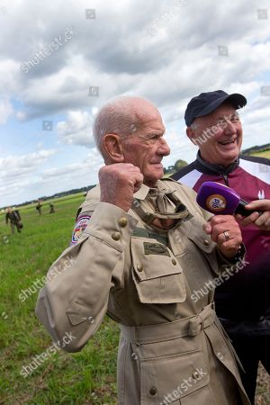 Stock Picture of Tom Rice, a 98-year-old American WWII veteran, and U.S. Ambassador Pete Hoekstra, right, talk to journalists after landing with a tandem parachute jump near Groesbeek, Netherlands, as part of commemorations marking the 75th anniversary of Operation Market Garden. Rice jumped with the U.S. Army's 101st Airborne Division in Normandy, landing safely despite catching himself on the exit and a bullet striking his parachute