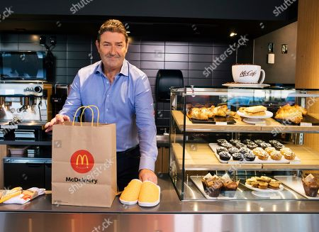 MCDONAD'S- In celebration of McDelivery Night In, McDonald's CEO Steve Easterbrook packs McDelivery orders with the McDelivery Night In merchandise at the McDonald's restaurant with a global menu at the company's headquarters in Chicago. McDonald's delivers to more than one million customers on average each day around the world, and this year, McDonald's third-annual global delivery celebration encourages everyone to spend a well-deserved McDelivery Night In