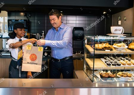 MCDONAD'S- McDonald's CEO Steve Easterbrook works with a crew member at the McDonald's restaurant with a global menu at the company's headquarters in Chicago to prepare McDelivery orders in celebration of McDelivery Night In on