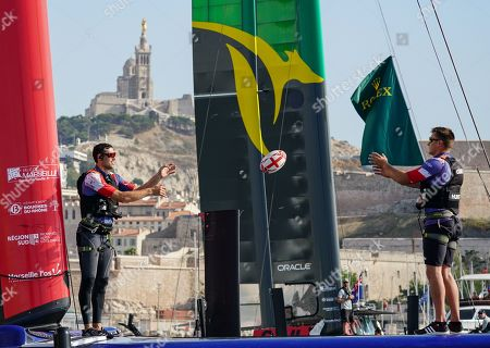 Matt Gotrel and Neil Hunter, grinders of Great Britain SailGP Team, play with an England Rugby World Cup 2019 onboard the Great Britain SailGP Team F50 catamaran as the teams celebrate the start of the Rugby World Cup in Japan. The final SailGP event of Season 1 in Marseille, France. 19 September 2019. Photo: Bob Martin for SailGP. Handout image supplied by SailGP