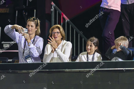 Stock Photo of Roger's Mother Lynette Federer (2-R) with his wife Mirka (L) and and his children watch Roger Federer, returning the ball during training of the Laver Cup in Geneva, Switzerland, 19 September 2019. The competition will pit a team of the best six European players against the top six from the rest of the world. The Laver Cup edition is scheduled for 20-22 September at the Palexpo in Geneva. The Laver Cup is named after the Australian tennis legend Rod Laver.