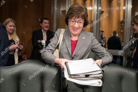 Senate Committee on Health, Education Labor and Pensions member Sen. Susan Collins, R-Maine, takes her seat for the hearing on Eugene Scalia's nomination to be Labor Secretary on Capitol Hill, in Washington