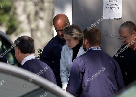 Michelle Carter, center, departs following a parole hearing on in Natick, Mass. Carter has served seven months of a 15-month jail term for urging her suicidal boyfriend Conrad Roy III via text messages to take his own life, after she was convicted in 2017 of involuntary manslaughter