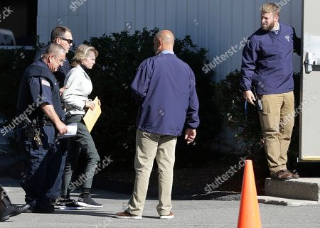 Michelle Carter, third from left, arrives for a parole hearing on in Natick, Mass. Carter has served seven months of a 15-month jail term for urging her suicidal boyfriend Conrad Roy III via text messages to take his own life, after she was convicted in 2017 of involuntary manslaughter