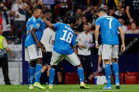 (L-R) Blaise Matuidi, Juan Cuadrado and Cristiano Ronaldo of Juventus celebrate goal during UEFA Champions League match between Atletico de Madrid and Juventus at Wanda Metropolitano Stadium in Madrid, Spain. Final score: Atletico de Madrid 2 - Juventus 2.