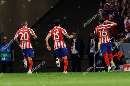 Stock Picture of (L-R) Victor Machin 'Vitolo?, Stefan Savic and Hector Herrera of Atletico de Madrid celebrate goal during UEFA Champions League match between Atletico de Madrid and Juventus at Wanda Metropolitano Stadium in Madrid, Spain. Final score: Atletico de Madrid 2 - Juventus 2.