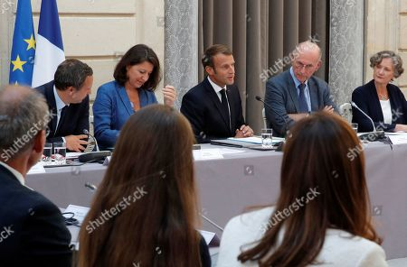 French President Emmanuel Macron (C) with President of the Commission French neuropsychiatrist Boris Cyrulnik (2-R) and French Minister for Solidarity and Health Agnes Buzyn (2-L) attend to inaugurate the Commission on the first 1000 days of the child in Paris, France, 19 September 2019.