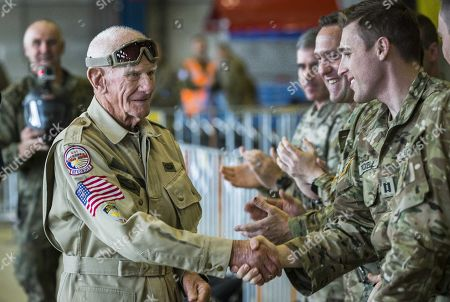 Stock Photo of US WWII veteran Tom Rice (98 years old) from California (L) greets soldiers prior to his anniversary parachute jump 75 years after Operation Market Garden landing in Arnhem, at Eindhoven Air Base in Eindhoven, the Netherlands, 19 September 2019. During the World War II, the Allies launched an airborne landing at the Dutch town Arnhem in September 1944. It was codenamed Operation Market Garden.