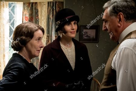 Phyllis Logan as Mrs. Hughes, Michelle Dockery as Lady Mary Talbot and Jim Carter as Mr. Carson
