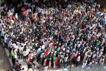 Sudanese protesters gather during a rally to demand justice for those killed during the uprising against ousted president Omar Hassan al-Bashir, in front of the Justice Ministry, in Khartoum, Sudan, 19 September 2019.
