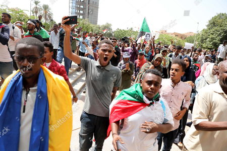 Sudanese protesters shout slogans during a rally to demand justice for those killed during the uprising against ousted president Omar Hassan al-Bashir, in front of the Justice Ministry, in Khartoum, Sudan, 19 September 2019.