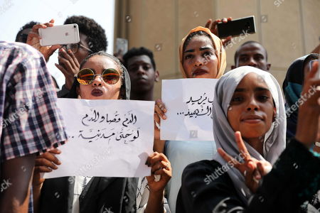 Sudanese protesters hold placard reading 'blood for blood' during a rally to demand justice for those killed during the uprising against ousted president Omar Hassan al-Bashir, in front of the Justice Ministry, in Khartoum, Sudan, 19 September 2019.