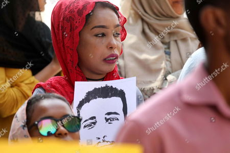 A Sudanese protester cries during a rally to demand justice for those killed during the uprising against ousted president Omar Hassan al-Bashir, in front of the Justice Ministry, in Khartoum, Sudan, 19 September 2019.
