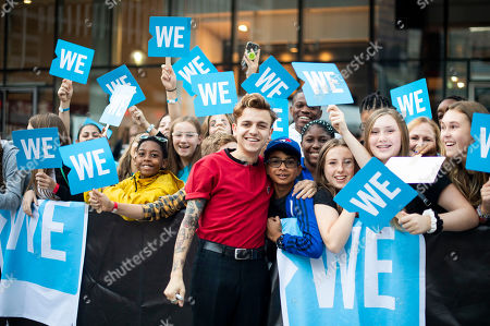 Scott Helman walks the WE carpet during WE Day Toronto at the Scotiabank Arena, in Toronto