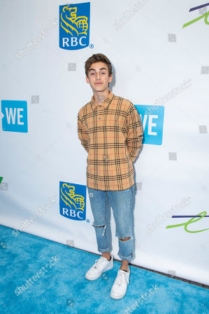 Johnny Orlando walks the WE carpet during WE Day Toronto at the Scotiabank Arena, in Toronto