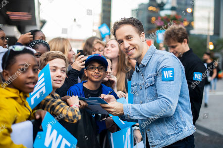 WE Charity co-founder Craig Kielburger walks the WE carpet during WE Day Toronto at the Scotiabank Arena, in Toronto
