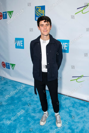 Connor Franta walks the WE carpet during WE Day Toronto at the Scotiabank Arena, in Toronto