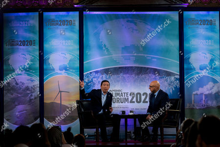 Democratic presidential candidate entrepreneur Andrew Yang, left. accompanied by moderator Ali Velshi, speaks during the Climate Forum at Georgetown University, in Washington
