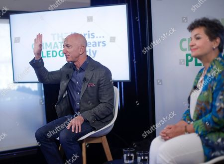 Amazon CEO Jeff Bezos, left, gestures while speaking during his news conference at the National Press Club in Washington, . Sitting next to Bezos is Christiana Figueres, right, former UN Head Global Optimism. Bezos announced the Climate Pledge, setting a goal to meet the Paris Agreement 10 years early