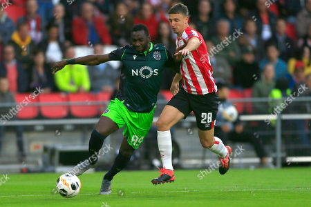 Sporting's Yannick Bolasie, left, and PSV's Olivier Boscagli, right, vie for the ball during the Europa League Group D soccer match between PSV and Sporting CP at the Philips stadium in Eindhoven, Netherlands