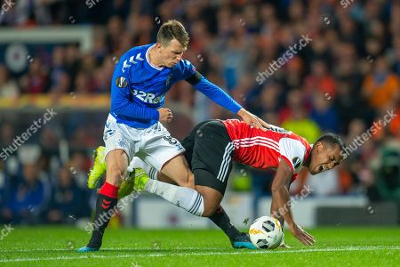 Ryan Jack (#8) of Rangers FC fouls Renato Tapia (#20) of Feyenoord Rotterdam during the Europa League match between Rangers FC and Feyenoord Rotterdam at Ibrox Stadium, Glasgow