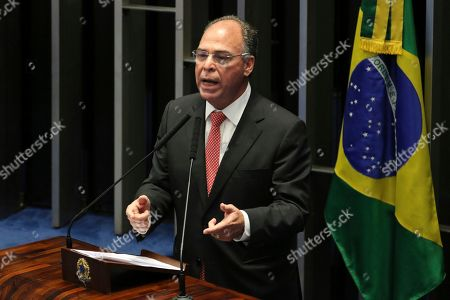 Released by the government news agency Agencia Brasil, Senator Fernando Bezerra Coelho speaks during a session at the Senate in Brasilia, Brazil. Bezerra Coelho is one of the targets of a federal police operation into a possible kick-back scheme allegedly carried out when he was in the Cabinet of former President Dilma Rousseff, according to authorities on Thursday, Sept. 19. 2019
