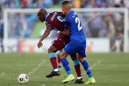 Trabzonspor's Alexander Sorloth, left, vies for the ball with Getafe's Faycal Fajr during Europe League Group C soccer match between Getafe and Trabzonspor at the Alfonso Perez stadium in Getafe, Spain