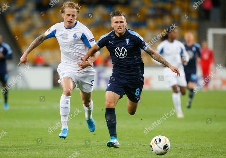 Malmo's Arnor Ingvi Traustason, right, and Dynamo Kyiv's Artem Shabanov challenge for the ball during the Europa League group B soccer match between Dynamo Kyiv and Malmo FF at the Olympiyskiy stadium in Kyiv, Ukraine