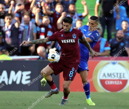Getafe's midfielder Faycal Fajr (R) and Trabzonspor's midfielder Jose Ernesto Sosa (L) in action during the Europa League group C match between Getafe and Trabzonspor at Coliseum Alfonso Perez stadium in Getafe, Madrid, Spain, 19 September 2019.