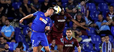 Getafe's forward Jaime Mata (L) vies for the ball against Trabzonspor's midfielder John Obi Mikel (R) during the Europa League group C match between Getafe and Trabzonspor at Coliseum Alfonso Perez stadium in Getafe, Madrid, Spain, 19 September 2019.