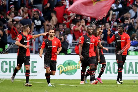 Rennes players celebrate after Rennes' M'Baye Niang, second right, scored his side's opening goal during the Europa League Group E soccer match between Rennes and Celtic, at the Roazhon Park stadium in Rennes, France
