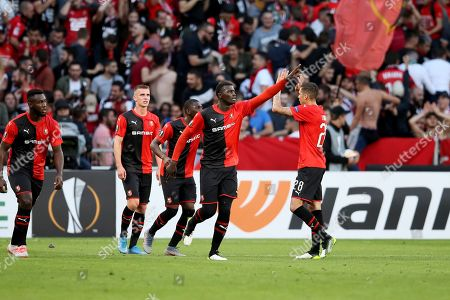 Rennes' M'Baye Niang, center, celebrates after scoring his side's opening goal during the Europa League Group E soccer match between Rennes and Celtic, at the Roazhon Park stadium in Rennes, France