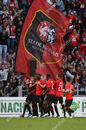 Rennes' M'Baye Niang, center left, celebrates with teammates after scoring his side's opening goal during the Europa League Group E soccer match between Rennes and Celtic, at the Roazhon Park stadium in Rennes, France