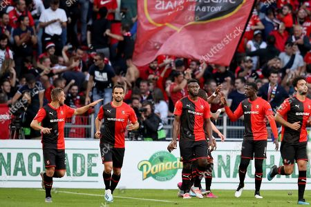 Rennes' M'Baye Niang, second right, celebrates with teammates after scoring his side's opening goal during the Europa League Group E soccer match between Rennes and Celtic, at the Roazhon Park stadium in Rennes, France