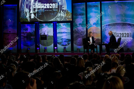 Democratic presidential candidate author Marianne Williamson, accompanied b ymoderator Ali Velshi, right, speaks during the Climate Forum at Georgetown University, in Washington