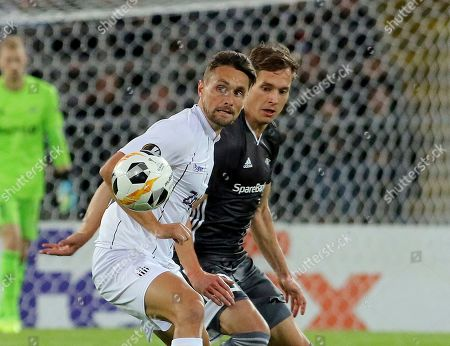 LASK's James Holland, left, challenges for the ball with Rosenborg's Anders Konradsen, during the Europa League Group D soccer match between LASK and Rosenborg BK at the Linz Stadium in Linz, Austria, Thursday, Sept .19, 2019