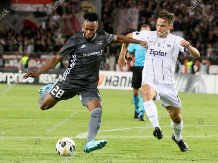 Rosenborg's Samuel Adegbenro, left, challenge for the ball with LASK's James Holland, during the Europa League Group D soccer match between LASK and Rosenborg BK at the Linz Stadium in Linz, Austria, Thursday, Sept .19, 2019