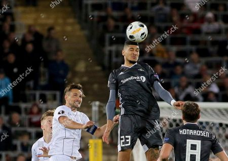 LASK's James Holland challenge for the ball with Rosenborg's Bjorn Maars Johnsen, from left, during the Europa League Group D soccer match between LASK and Rosenborg BK at the Linz Stadium in Linz, Austria, Thursday, Sept .19, 2019