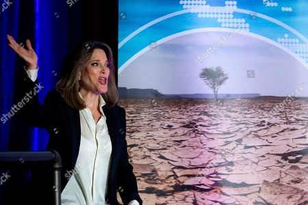 Democratic presidential candidate author Marianne Williamson waves during the Climate Forum at Georgetown University, in Washington