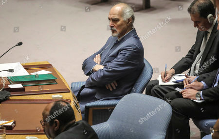 Stock Photo of Syria's United Nations Ambassador Bashar Jaafari listen during a U.N. Security Council's meeting on Syria, at U.N. headquarters