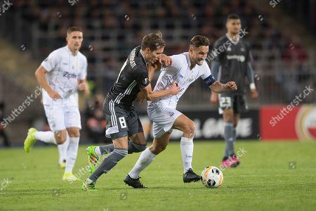 Rosenborg's  Anders Konradsen (L) in action against Lask's James Holland (R) during the UEFA Europa League group D soccer match between LASK and Rosenborg BK, in Linz, Austria, 19 September 2019.
